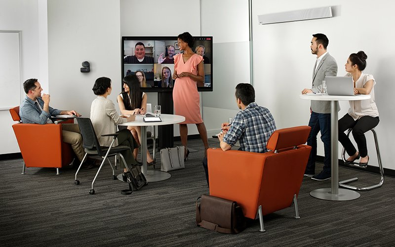 Meeting featuring Nureva audio conferencing system and Logitech products