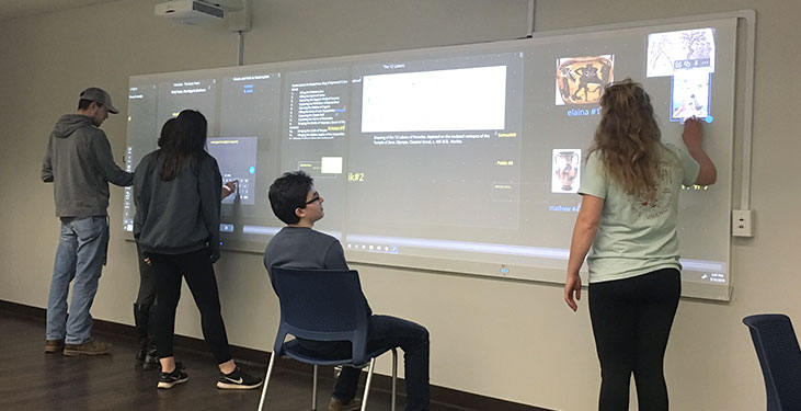 Brevard College students collaborating with Span Workspace