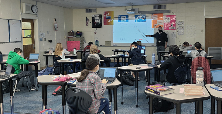 Hybrid learning classroom with students in the classroom and remote