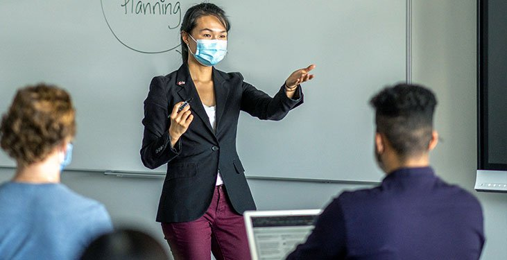 Students debate in a hybrid learning classroom
