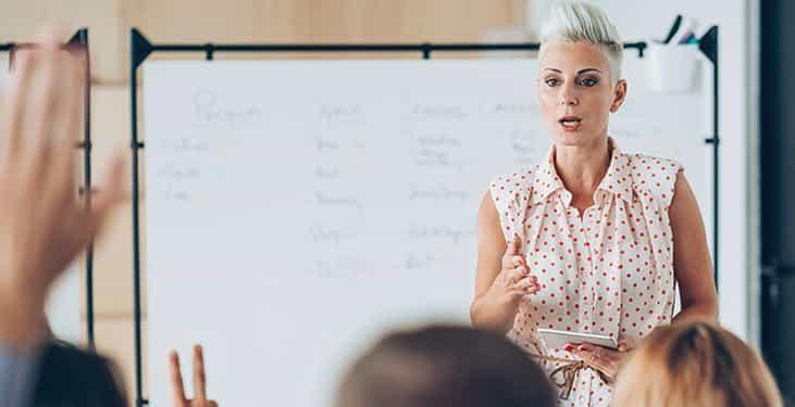Instructor teaching in a HyFlex classroom