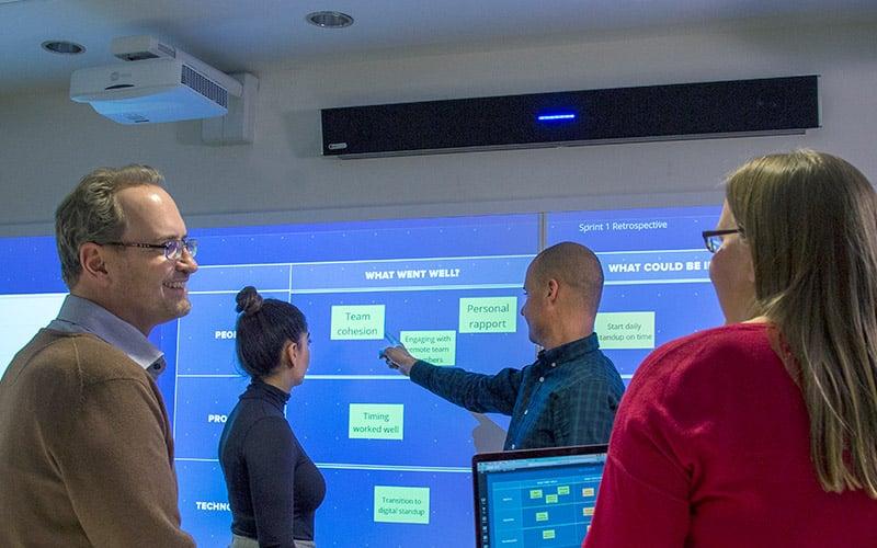 Team using Nureva Span Workspace and Nureva Wall