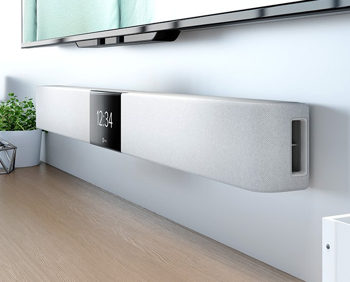 Nureva HDL200 system in light color mounted on the wall below an interactive flat panel display