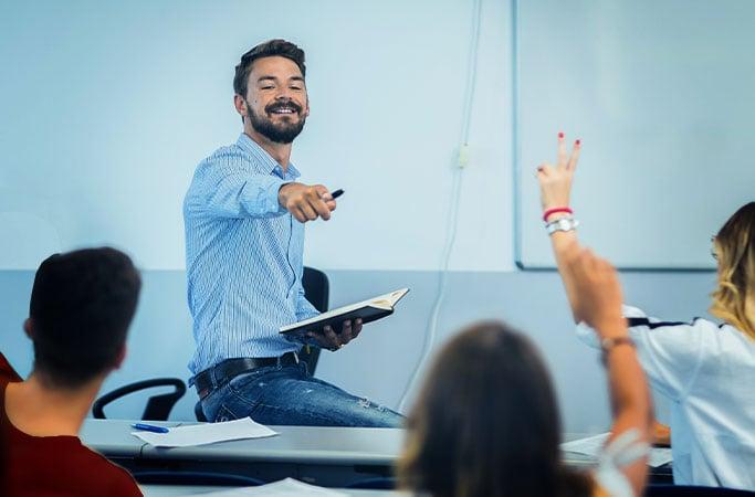 Male teacher in K-12 education classroom
