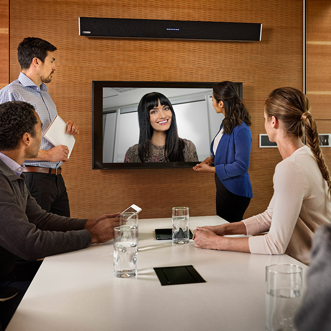Remote worker joins her team meeting using the HDL300 audio conferencing system
