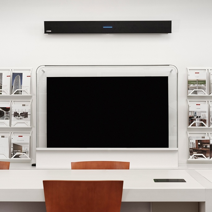 Modern interior design office with a black Nureva HDL300 audio conferencing system