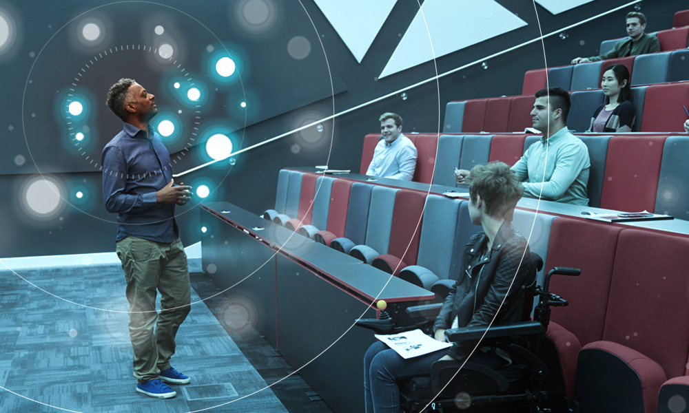 Professor in higher education classroom using Nureva audio Active Zone Control feature